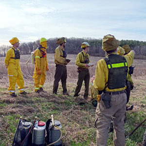 Men preparing for a controller burn
