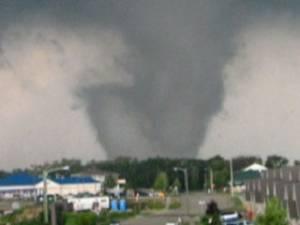 Large tornado approaching a city